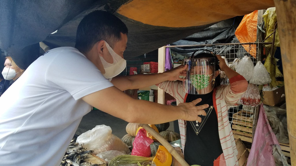 Faceshield distribution to street and market vendors.