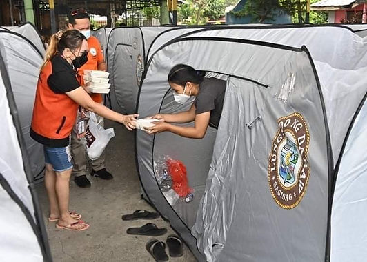 Office of Pulong distributes food packs, cash aid to Matina Aplaya fire victims