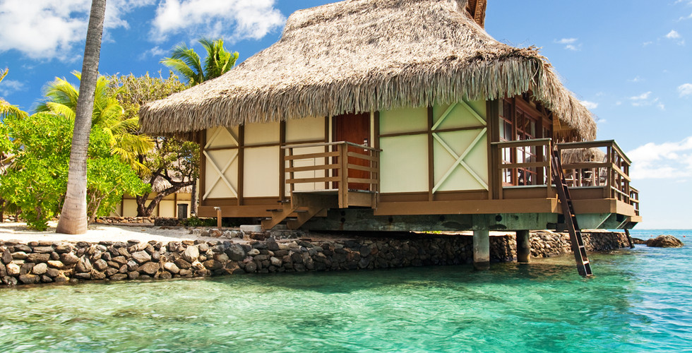 Over water bungalow with steps into amaz