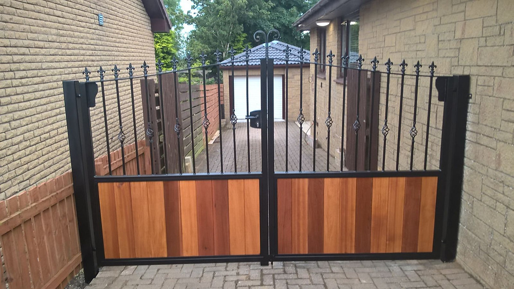 wrought iron and timber cladded gates