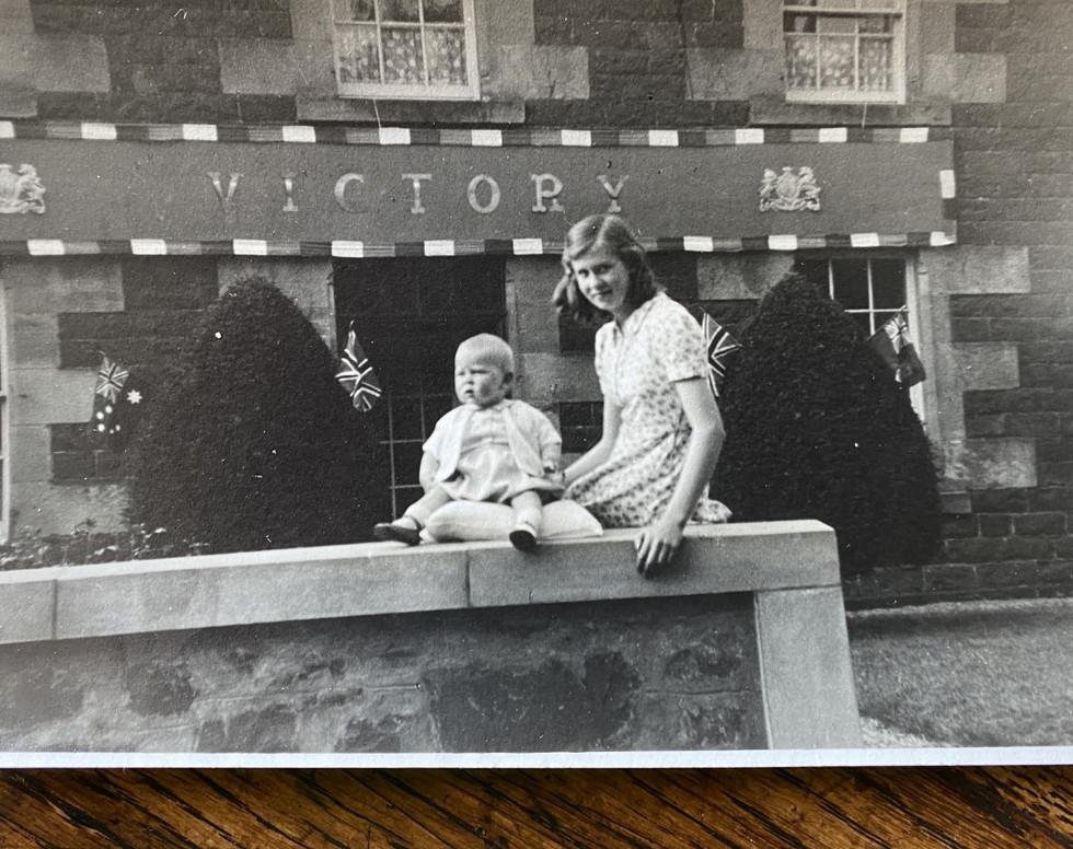 Christine Taylor outside her house.jpg