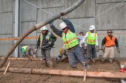 Pouring Cement for Stadium Walkway