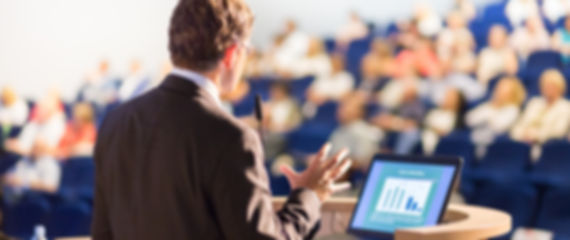 bigstock-Speaker-at-Business-Conference-