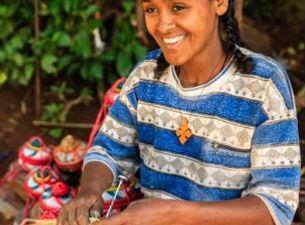 Woman weaving basket.JPG
