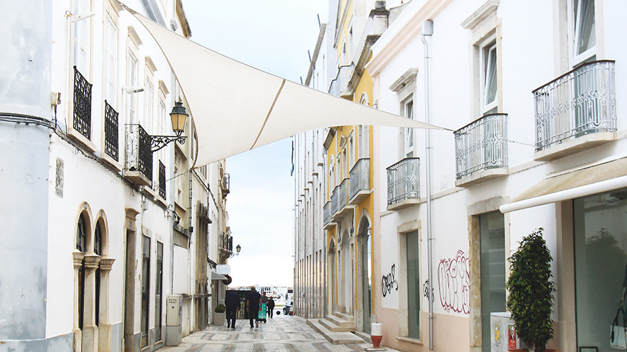 Charming streets in Faro with whitewashed buildings and tiled streets