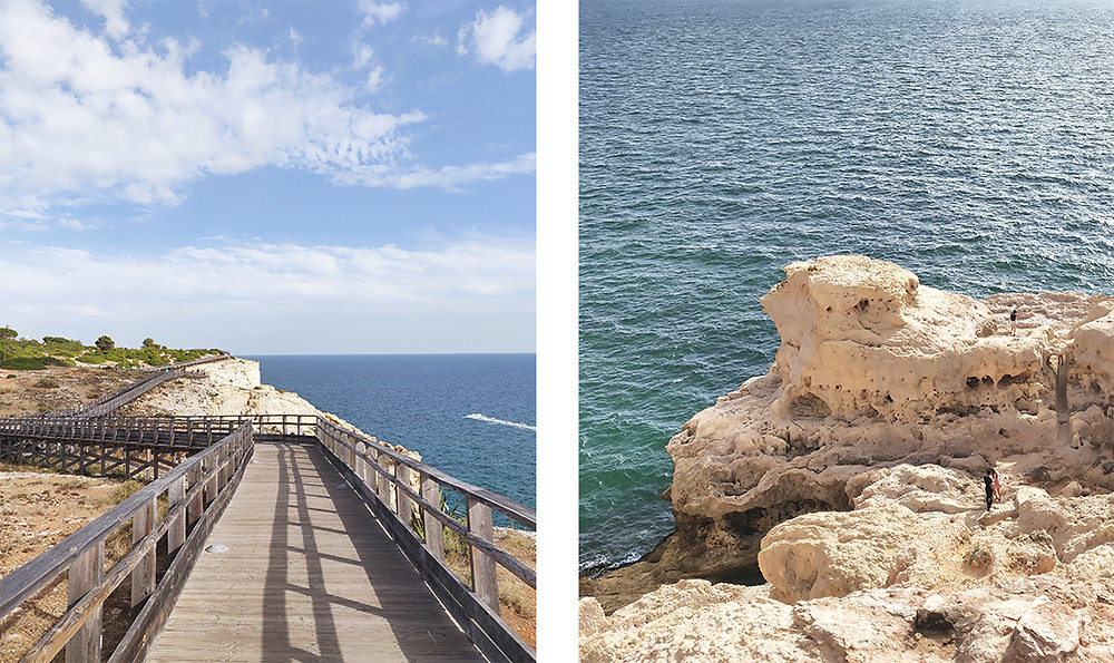 View of white cliffs and caves from Algar Seco boardwalk in Carvoeiro, Algarve