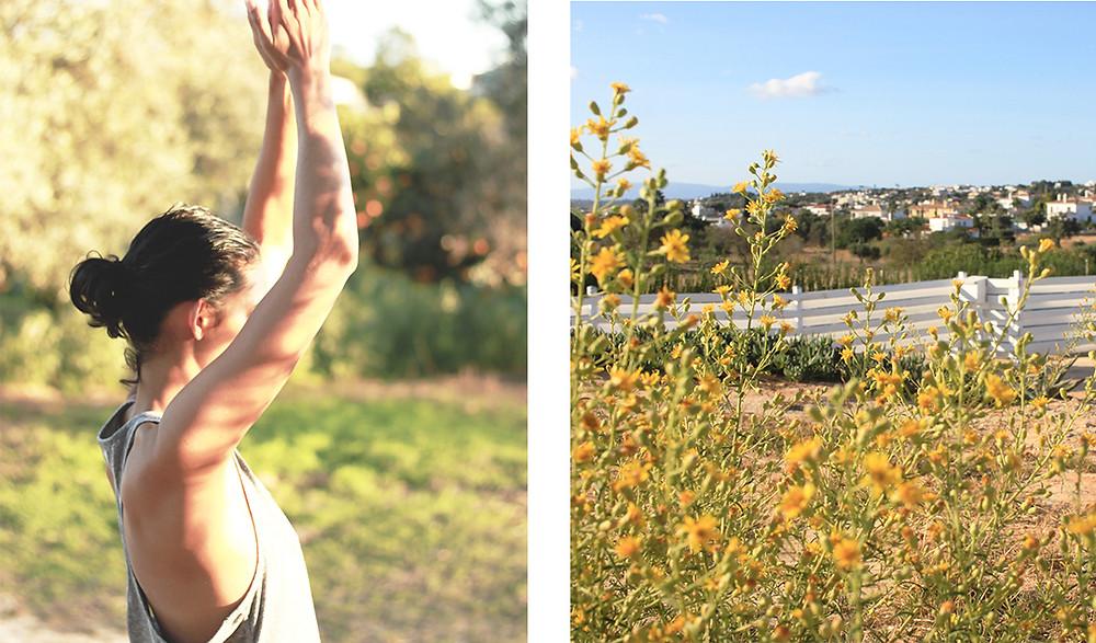 Girl doing yoga outside in the beautiful nature while enjoying beautiful views.