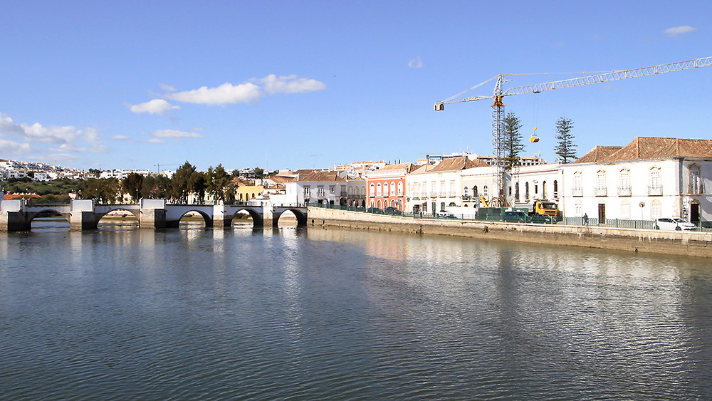 The roman bridge and river running through the old town in Tavira, Algarve
