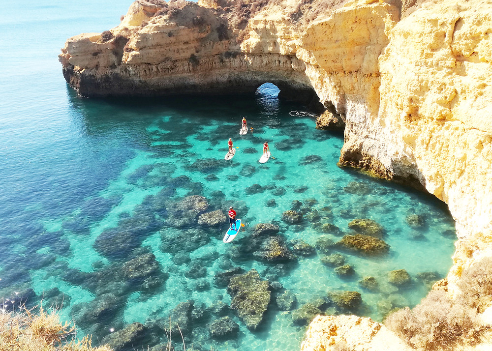 Stand up paddle surf tour on green waters and big cliffs
