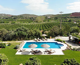 Airbnb photo of a blue pool with mountain views in Algarve