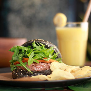 a buger with sallad and a smoothie foodie picture from instagram