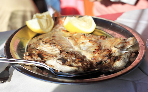 Fresh grilled fish at the local restaurant A Grelha Do Ti-Manel