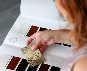 Product photography of a girl looking at textile samples