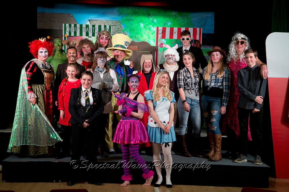 The cast of Alice in Wonderland (and the piano player!)