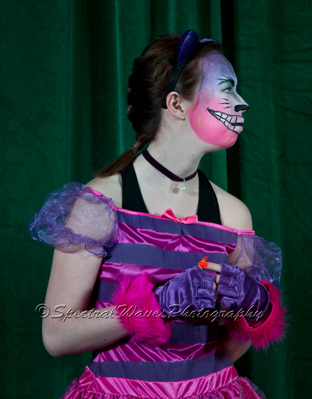 Mia Brend as the Cheshire Cat
