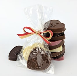 Heart shaped solid chocolates in clear compostable bags