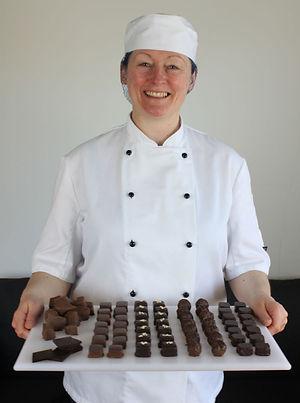 Chocolatier Karen Garner holding a tray of handmade chocolates