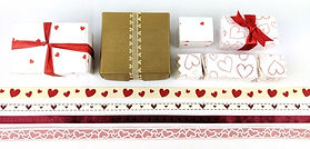 A selction of ballotin boxes for chocolates and ribbons with heart motifs