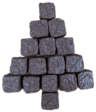 Handmade chocolate gingerbread truffles stacked in the shape of a christmas tree
