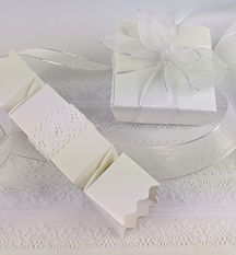 White ballotin boxes for chocolates with lace ribbons