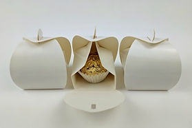 Decorative white tote boxes to hold a single chocolate