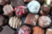A luxury selection of milk, white and dark, artisan handmade chocolates and truffles.