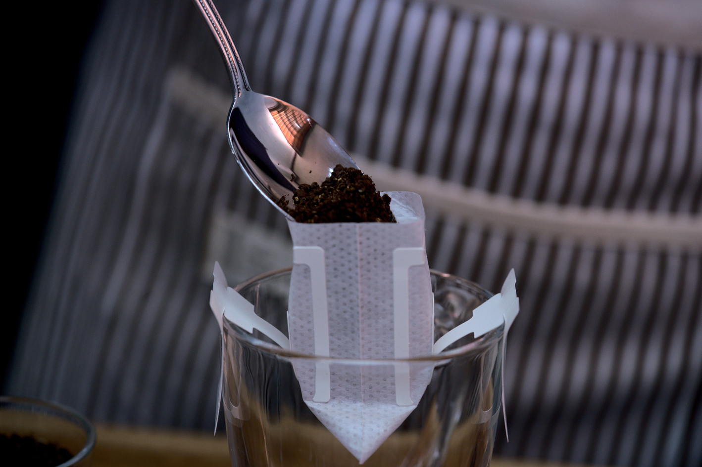 hand drip filter pouring coffee