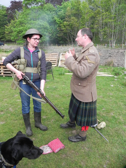 The re-enactor talks to the public