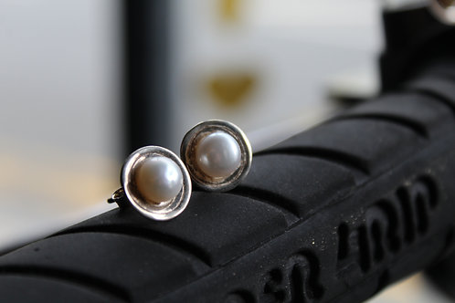 Pearl and Silver Stud Earrings with a textured silver disc