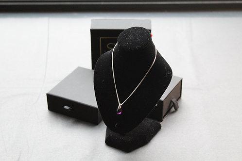 "Swarovski Amethyst Gemstone Pendant on an 18"" Sterling Silver Chain."