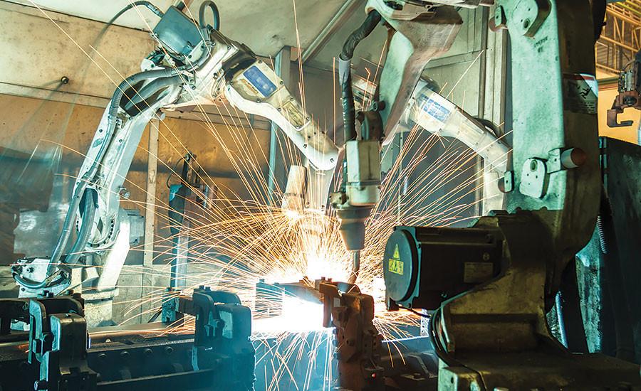 "alt=""welding robots in manufacturing safeguarding"""