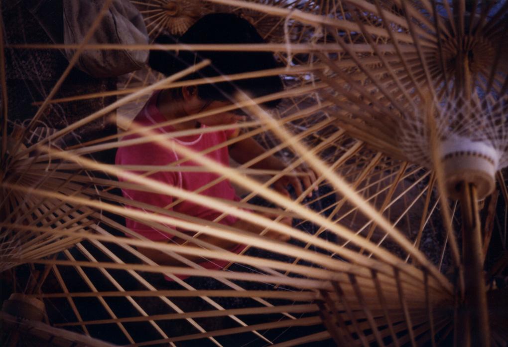 Antoine Roulet-Thai girl in umbrellas.jpg