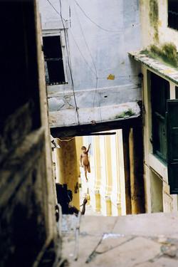 India-Varanasi-Boy in back street.jpg