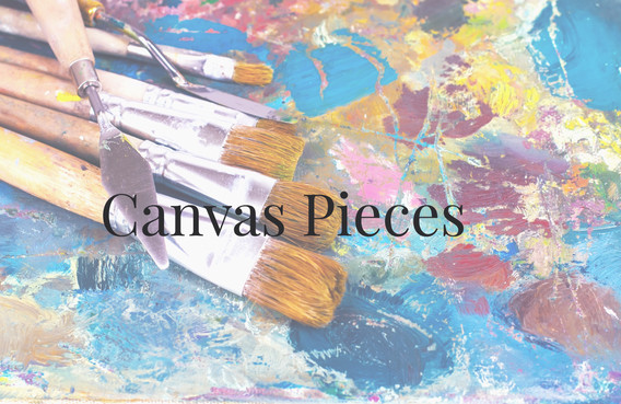 artist's palette with oil paints and bru
