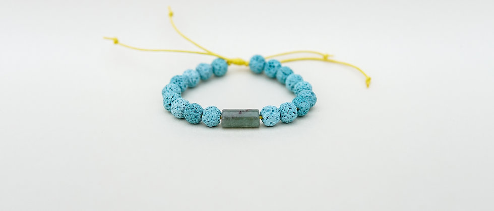 Light Blue Lava with one Green Aventurina stone on Yellow String