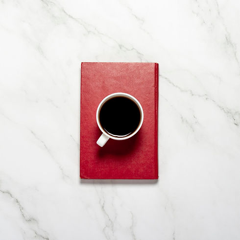 cup-with-coffee-tea-red-book-marble-tabl