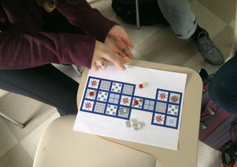 Students playing the Royal Game of Ur using print outs