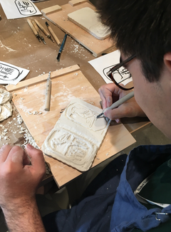 Students carving their ancient Egyptian reliefs