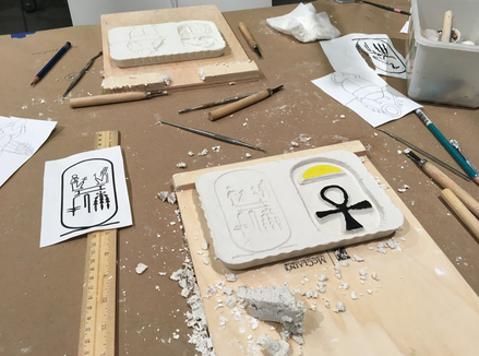 Student work for the Carving Ancient Egyptian Reliefs activity (gypsum carved with hieroglphs)