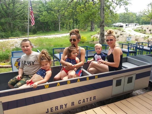 Family on Train with flag.jpeg