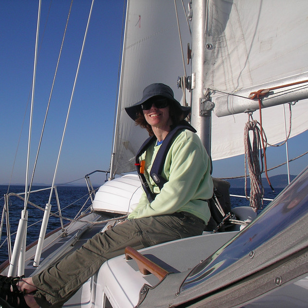 Kelly relaxing on foredeck 1.JPG
