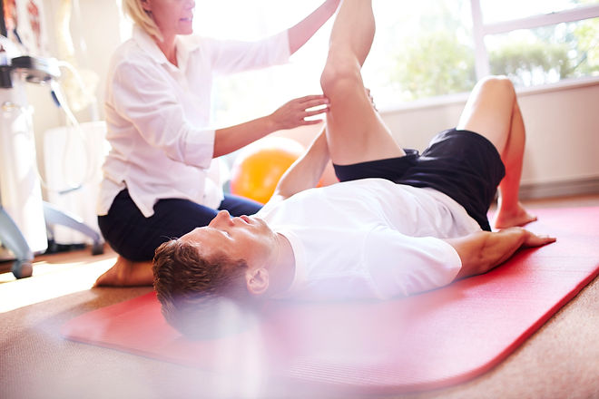 physical-therapist-stretching-mans-leg-5