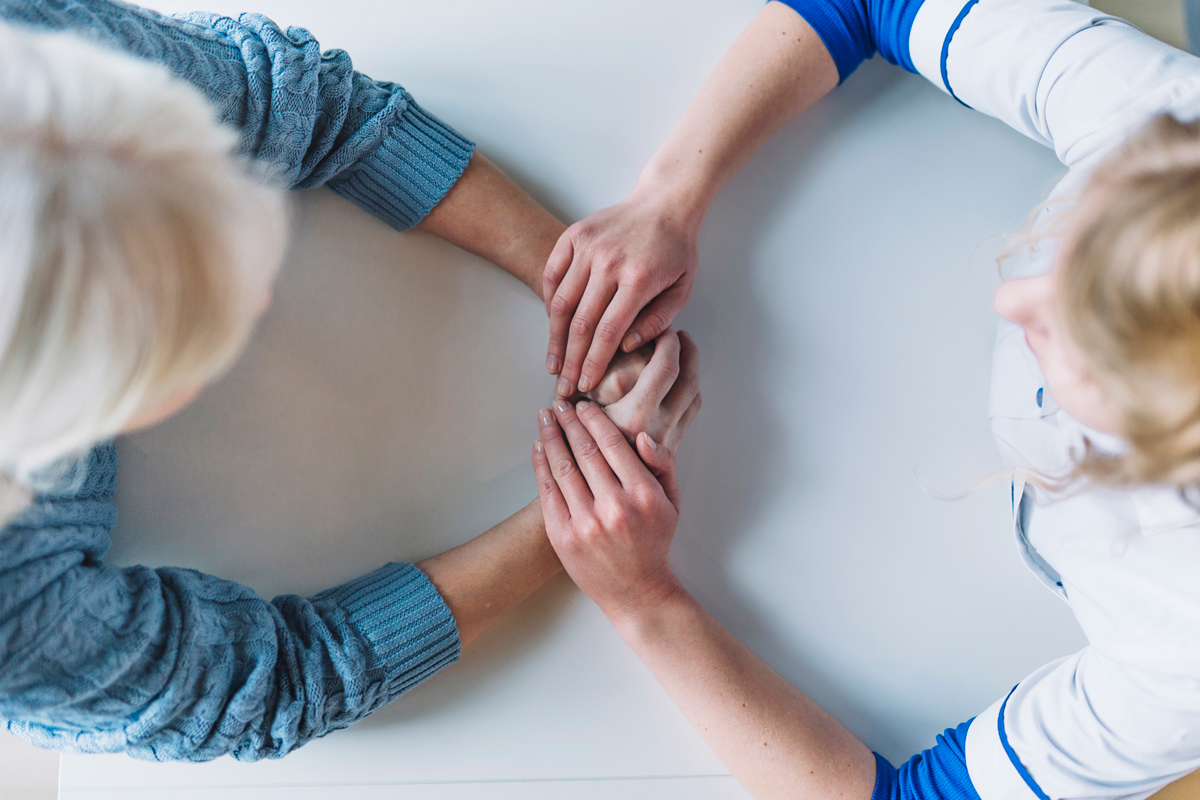 South-Florida-Rehabilitation-Consultants-patient-therapist-holding-hands.jpg