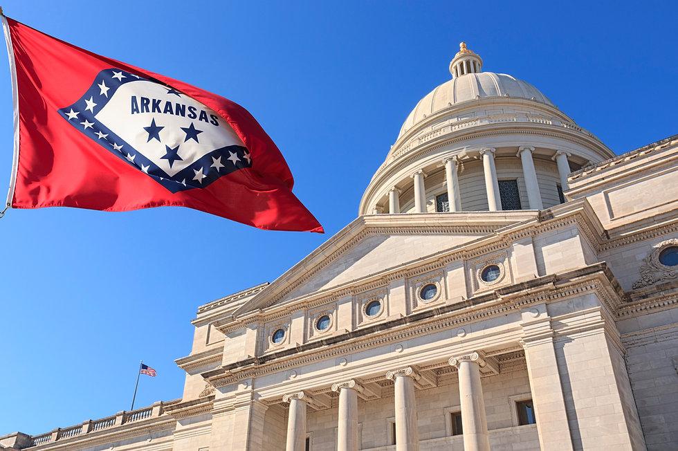 Arkansas-flag-flying-high-beside-the-Sta