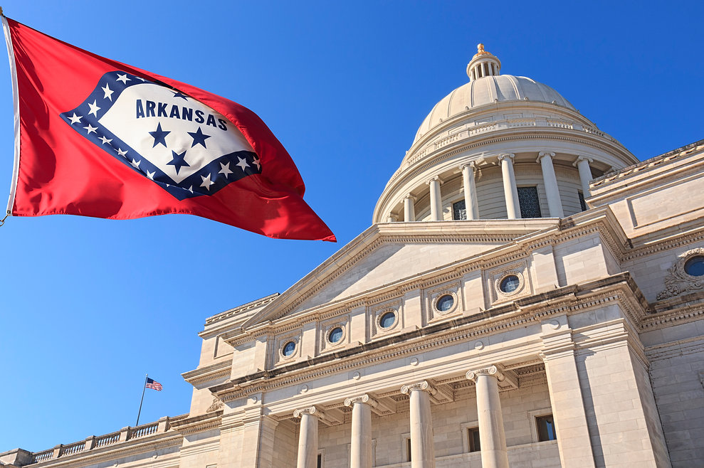 Arkansas-flag-flying-high-beside-the-Sta