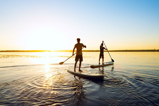 Men, friends are paddling on a SUP board