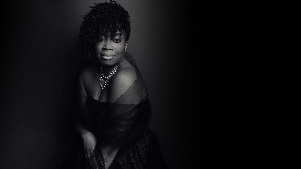 curvy-woman-in-evening-gown-in-studio-portrait.jpg