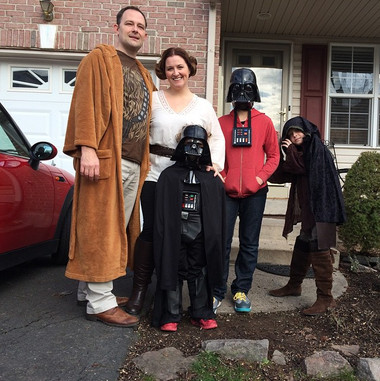 family-dressed-up-in-starwars-costumes.jpg
