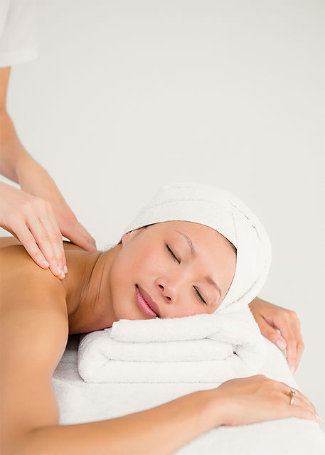 A woman relaxing during a massage appointment that she booked using Bookwell's online marketplace