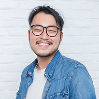 Bookwell support team smiling man with glasses